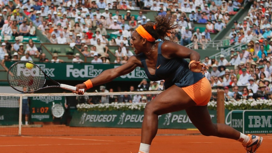 June 8, 2013: Serena Williams of the U.S. returns against Russia's Maria Sharapova in the women's final of the French Open tennis tournament, at Roland Garros stadium in Paris.