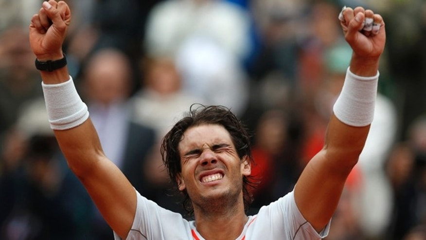June 9, 2013: Spain's Rafael Nadal reacts after defeating compatriot David Ferrer in the men's  final match of the French Open tennis tournament at the Roland Garros stadium in Paris. Nadal won 6-3, 6-2, 6-3.