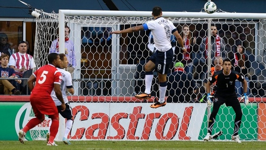 USA's Clint Dempsey, second from right, leaps for a ball as Panama goalkeeper Jaime Penedo right, eyes the shot in the first half of a World Cup qualifier soccer match, Tuesday, June 11, 2013, in Seattle. (AP Photo/Ted S. Warren)