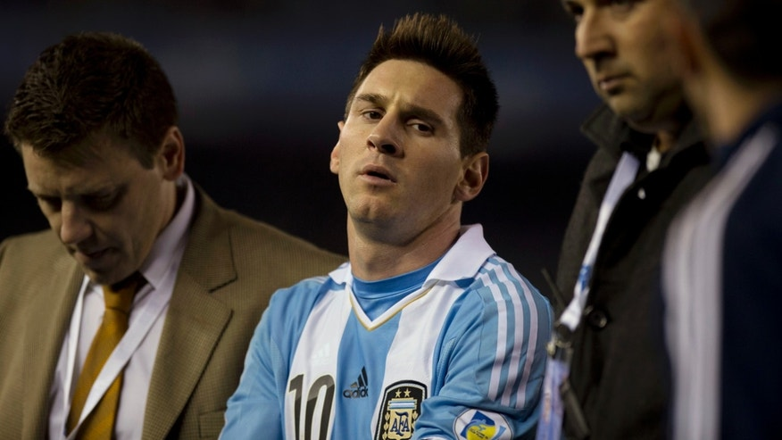 Argentina's Lionel Messi leaves the field after a 2014 World Cup qualifying soccer match against Colombia in Buenos Aires, Argentina, Friday, June 7, 2013. The match ended 0-0. (AP Photo/Eduardo Di Baia)