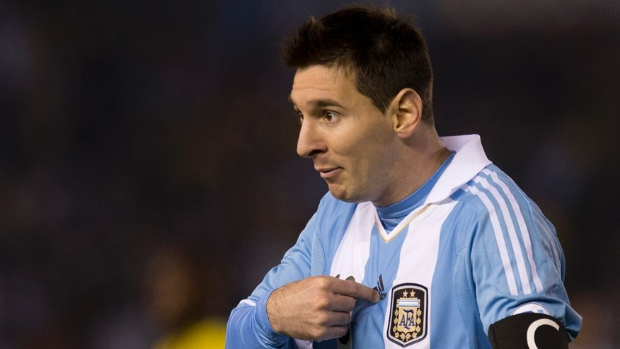 In this picture taken June 7, 2013 FC Barcelona's Lionel Messi, playing for Argentina,  gestures to the referee after a goal by Sergio Aguero was disallowed due to an off-side of Messi during a 2014 World Cup qualifying soccer match against Colombia in Buenos Aires, Argentina.  Barcelona's current and former presidents set aside their differences and defended Lionel Messi against allegations of tax fraud on Thursday, a case that experts say could carry a prison sentence for the Argentina star. A Spanish state prosecutor filed a fraud complaint on Wednesday alleging that Messi and his father Jorge avoided paying 4 million euros ($5.3 million) in back taxes on earnings from image rights during 2006-2009 by using illegal overseas tax havens.(AP Photo/Eduardo Di Baia)
