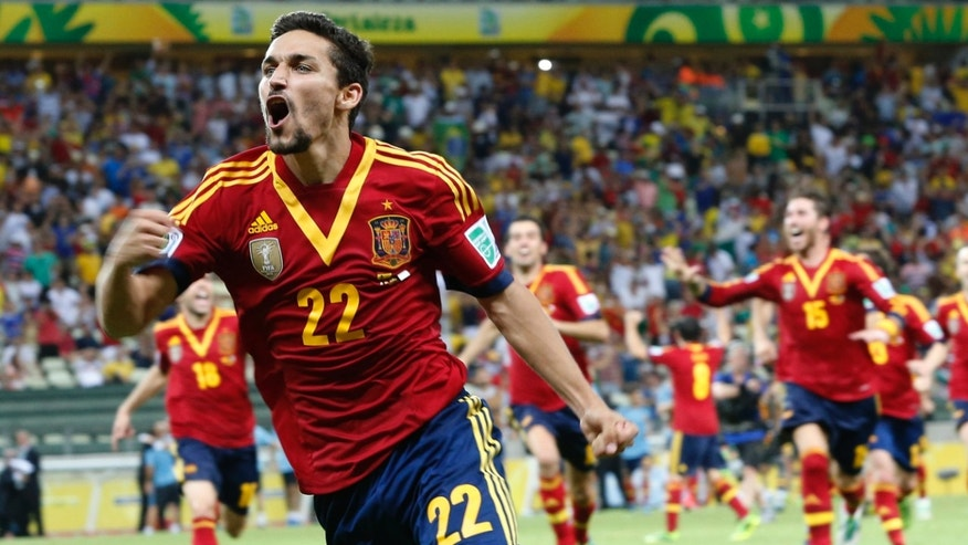 Spain's Jesus Navas celebrates after scoring his side winning penalty against Italy during the soccer Confederations Cup semifinal match at the Castelao stadium in Fortaleza, Brazil, Thursday, June 27, 2013.