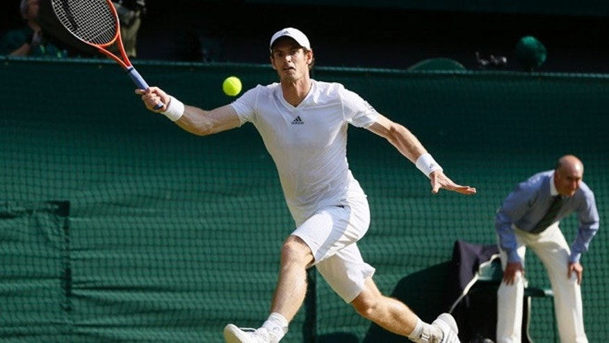 July 7, 2013: Andy Murray of Britain returns to Novak Djokovic of Serbia during the Men's singles final match at the All England Lawn Tennis Championships in Wimbledon, London, Sunday, July 7, 2013.