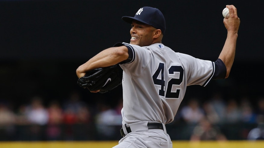 New York Yankees closing pitcher Mariano Rivera throws in the ninth inning of a baseball game against the Seattle Mariners, Sunday, June 9, 2013, in Seattle. Rivera earned the save as the Yankees defeated the Mariners 2-1. (AP Photo/Ted S. Warren)