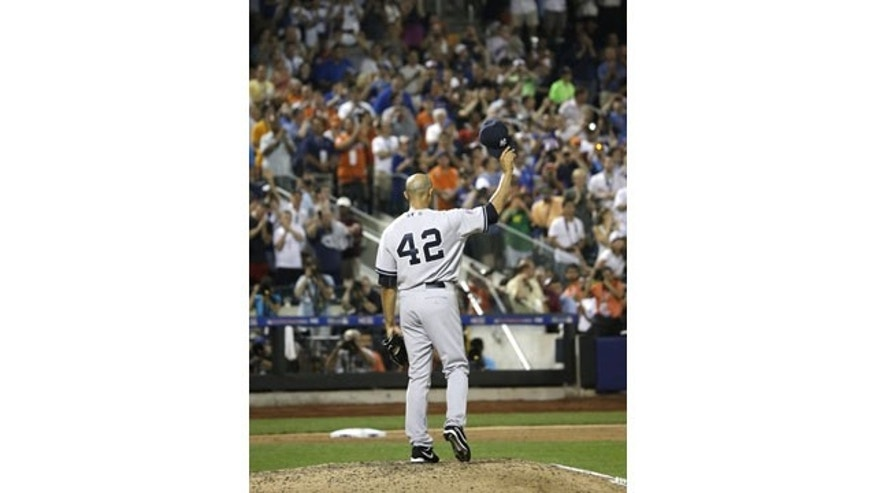 July 16, 2013:  Mariano Rivera, of the New York Yankees, acknowledges a standing ovation during the eighth inning of the MLB All-Star baseball game. (AP Photo/Matt Slocum)