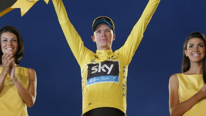 July 21 2013: 2013 Tour de France cycling race winner Christopher Froome of Britain, wearing the overall leader's yellow jersey, celebrates on the podium of the 100th edition of the Tour de France cycling in Paris, France.