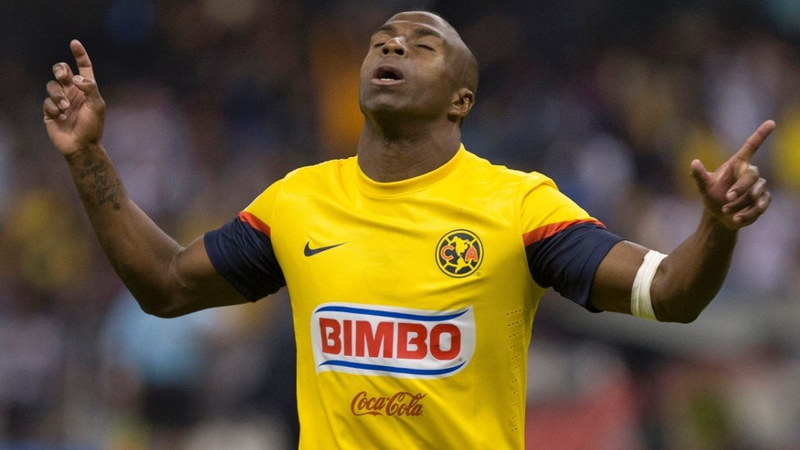 FILE - In this Jan. 19, 2013 file photo, America's Christian Benitez, celebrates his goal against Atlante at a Mexican soccer league match in Mexico City. Benitez, from Ecuador, died Monday, July 29, 2013, a day after playing in a match for Qatari club El Jaish, the team said. The club provided no further details about the death of the 27-year-old Benitez, who moved from Mexican club America to play in Qatar in 2013. (AP Photo/Christian Palma, File)