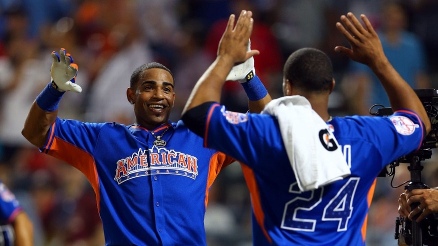 NEW YORK, NY - JULY 15:  Yoenis Cespedes of the Oakland Athletics celebrates with Robinson Cano of the New York Yankees after winning the Chevrolet Home Run Derby on July 15, 2013 at Citi Field in the Flushing neighborhood of the Queens borough of New York City.  (Photo by Elsa/Getty Images)