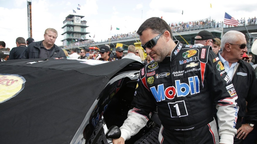 Sprint Cup Series driver Tony Stewart prepares for the Brickyard 400 auto race at the Indianapolis Motor Speedway in Indianapolis, Sunday, July 28, 2013. (AP Photo/Darron Cummings)