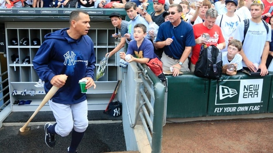 Aug. 7, 2013: New York Yankees' Alex Rodriguez heads to a batting cage before a baseball game against the Chicago White Sox in Chicago.