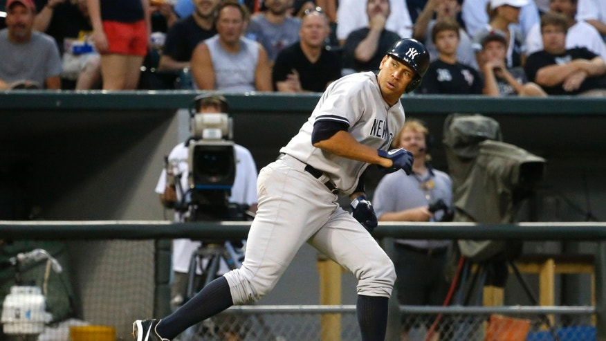 New York Yankees' Alex Rodriguez hustles back to third and is unable to score on Vernon Wells' bloop RBI-single off a pitch from Chicago White Sox's Hector Santiago during the third inning of a baseball game on Wednesday, Aug. 7, 2013, in Chicago. (AP Photo/Charles Rex Arbogast)
