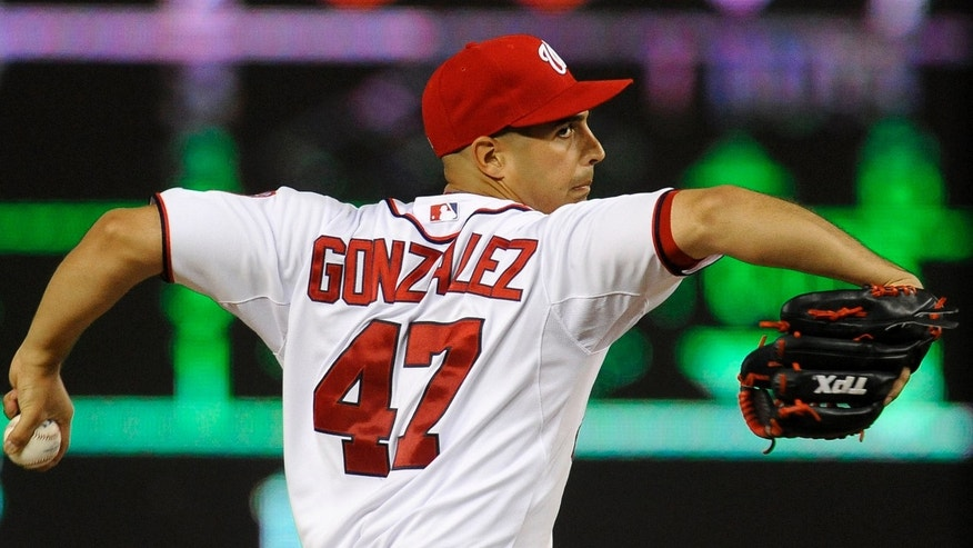 Washington Nationals' starting pitcher Gio Gonzalez delivers in the seventh inning to the Chicago Cubs during their baseball game at Nationals Park, Wednesday, Sept. 5, 2012, in Washington. The Nationals defeated the Cubs 9-1 and Gonzalez won his 18th game of the season. (AP Photo/Richard Lipski)