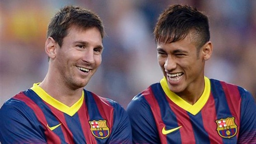 Lionel Messi and Neymar before a match against Santos on Friday, Aug. 2, 2013, in Barcelona.