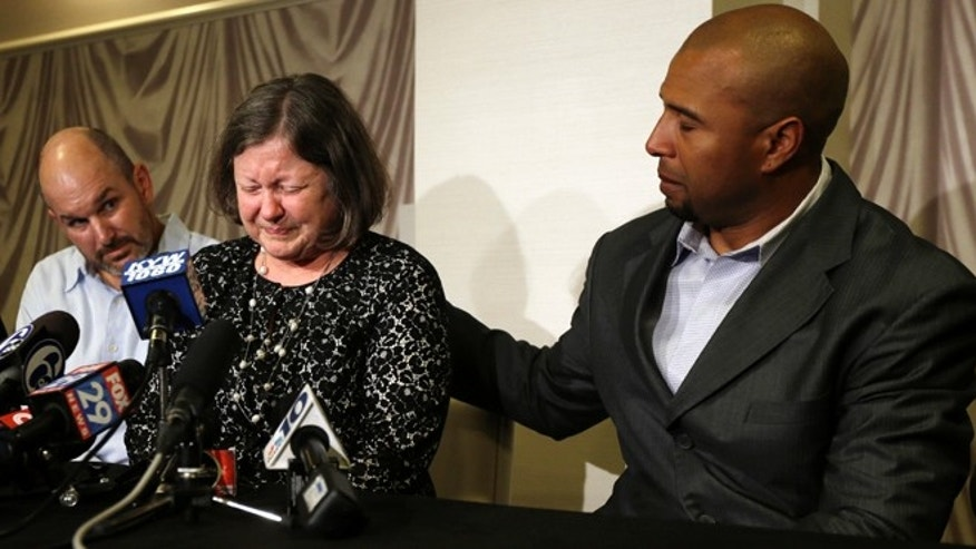 April 9, 2013: Former NFL player Dorsey Levens, right, extends a hand as Mary Ann Easterling, the widow of former NFL football player Ray Easterling, reacts as former NFL player Kevin Turner, left, looks on during a news conference in Philadelphia, after a hearing to determine whether the NFL faces years of litigation over concussion-related brain injuries.  (AP/Matt Rourke, File)