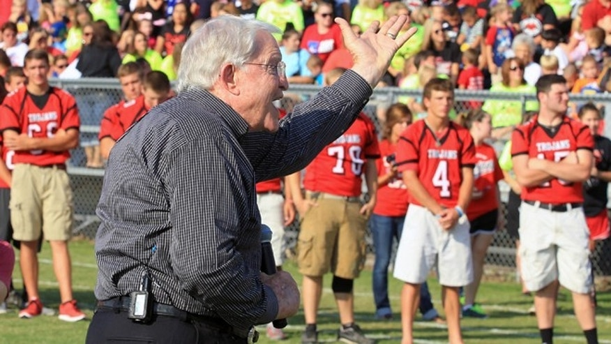 Aug 29, 2013: Former Baylor head football coach Grant Teaff addresses the West Trojan football players, background, and the community at a morning pep rally in West, Texas.