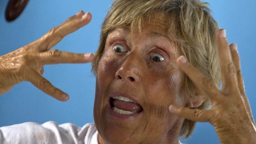 U.S. swimmer Diana Nyad, 64, gestures as she explains the jellyfish bites she experienced in her previous attempt to swim from the Florida Straits to the U.S. mainland, in Havana, Cuba, Friday, Aug. 30, 2013. The U.S. marathon swimmer arrived in Cuba Friday for her fifth attempt to swim across the Florida Straits to the U.S. mainland without a protective cage toward off shark attacks. The grueling swim is scheduled to start early Saturday, weather permitting. (AP Photo/Ramon Espinosa)