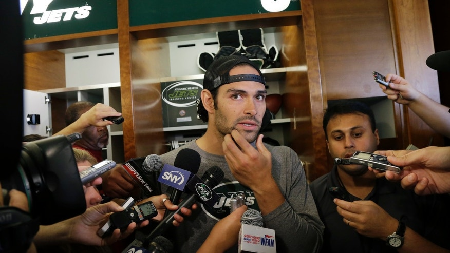 Quarterback Mark Sanchez rubs his chin as he listens to a question after New York Jets football practice in Florham Park, N.J., Monday, Sept. 2, 2013.  (AP Photo/Mel Evans)