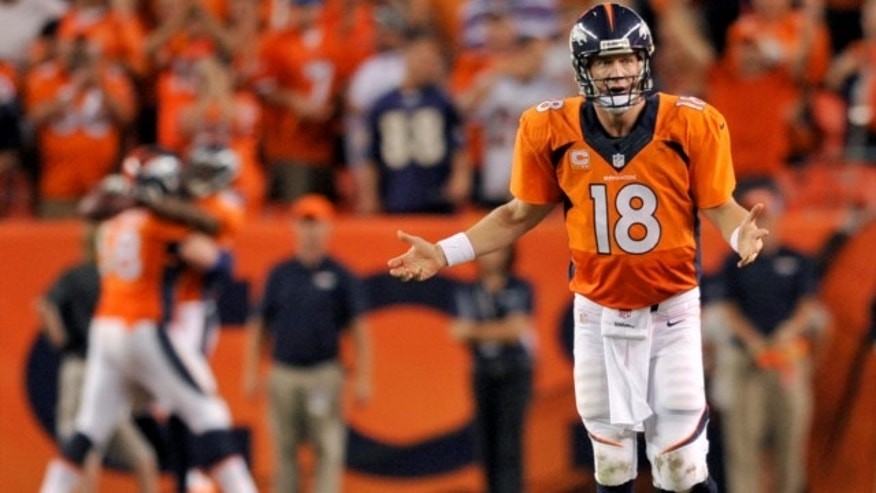 Sept. 5, 2013: Denver Broncos quarterback Peyton Manning (18) celebrates his seventh touchdown of the game against the Baltimore Ravens during the second half of an NFL football game in Denver.