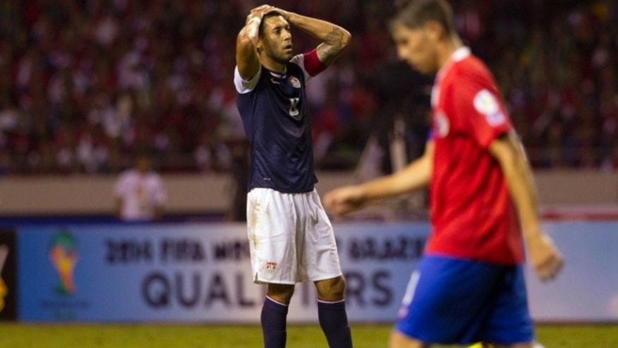 United States' Clint Dempsey pauses after missing a chance to score against Costa Rica at a 2014 World Cup qualifier soccer match in San Jose, Costa Rica, Friday, Sept. 6, 2013. (AP Photo/Moises Castillo)