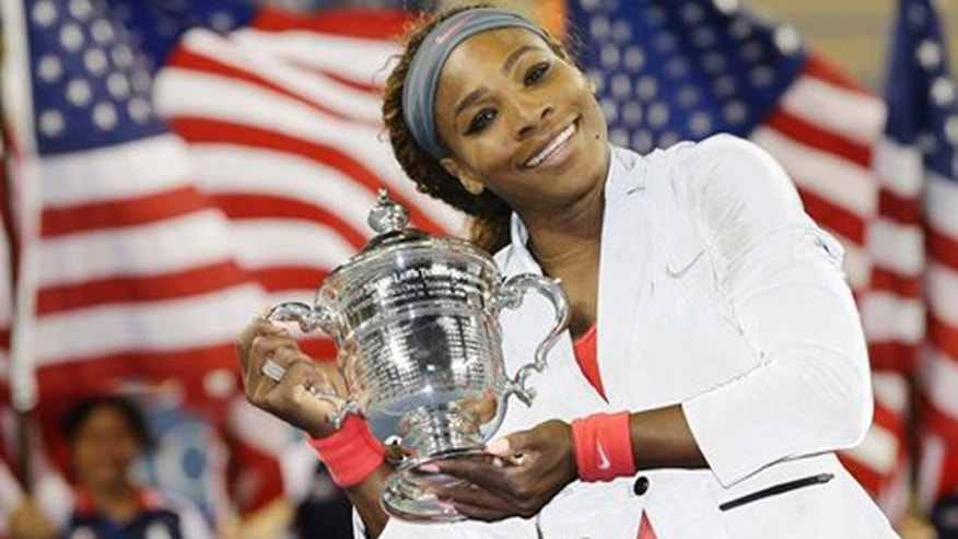 Sept. 8, 2013: Serena Williams holds up the championship trophy after defeating Victoria Azarenka, of Belarus, during the women's singles final of the 2013 U.S. Open tennis tournament.