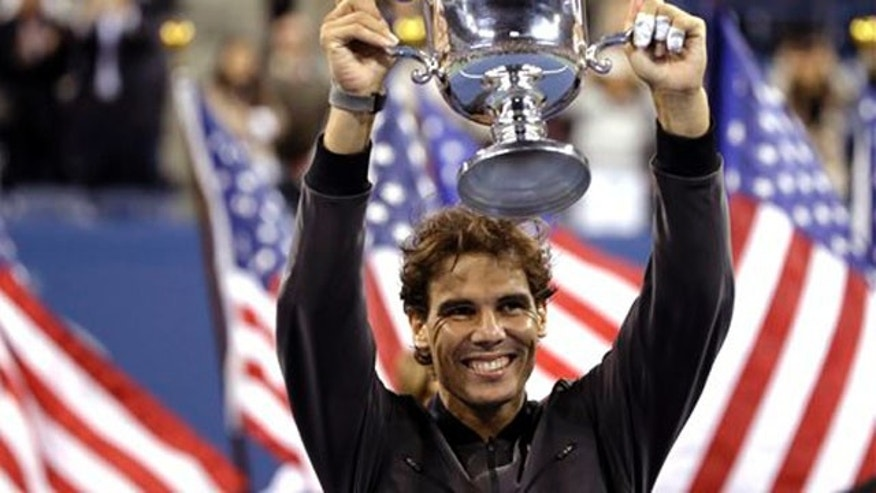 Sept. 9, 2013: Rafael Nadal, of Spain, holds up the championship trophy after beating Novak Djokovic, of Serbia, during the men's singles final of the 2013 U.S. Open tennis tournament.