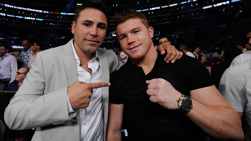 Oscar De La Hoya and Mexican boxer Canelo Alvarez on June 23, 2012 in Los Angeles, California.