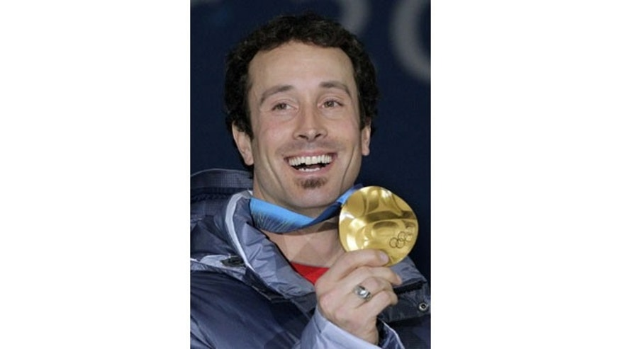 FILE - In this Tuesday, Feb. 16, 2010 photo USA's gold medalist Seth Wescott shows off his medal at the men's snowboard cross medal ceremony at the Vancouver 2010 Olympics in Vancouver, British Columbia. (AP Photo)