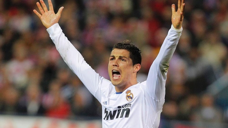 Real Madrid's Cristiano Ronaldo from Portugal reacts during a Spanish La Liga soccer match against Atletico Madrid at the Vicente Calderon stadium in Madrid, Saturday, March 19, 2011. (AP Photo/Andres Kudacki)