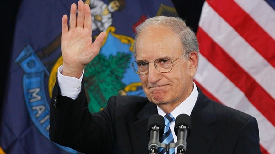 In this March 30, 2012 file photo, former Senate Majority Leader George Mitchell acknowledges the crowd after speaking at a campaign stop for President Obama at Southern Maine Community College in South Portland, Maine.