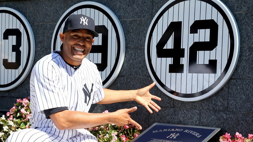 Mariano River next to his retired number in Monument Park before the game against the San Francisco Giants on September 22, 2013.