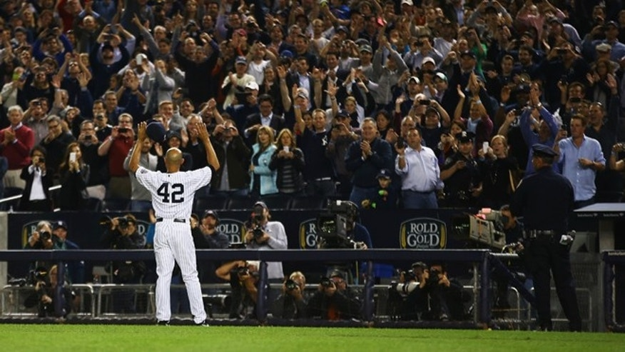 Mariano Rivera waves to the crowd on September 26, 2013 at the Yankee Stadium.