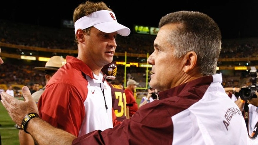 Sept. 28, 2013: Southern California head coach Lane Kiffin shakes hands with Arizona State head coach Todd Graham after an NCAA college football game in Tempe, Ariz.
