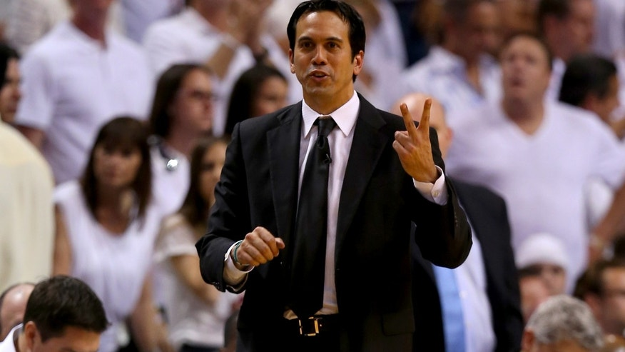 MIAMI, FL - JUNE 20:  Head coach Erik Spoelstra of the Miami Heat calls out in the third quarter while taking on the San Antonio Spurs during Game Seven of the 2013 NBA Finals at AmericanAirlines Arena on June 20, 2013 in Miami, Florida. NOTE TO USER: User expressly acknowledges and agrees that, by downloading and or using this photograph, User is consenting to the terms and conditions of the Getty Images License Agreement.  (Photo by Mike Ehrmann/Getty Images)
