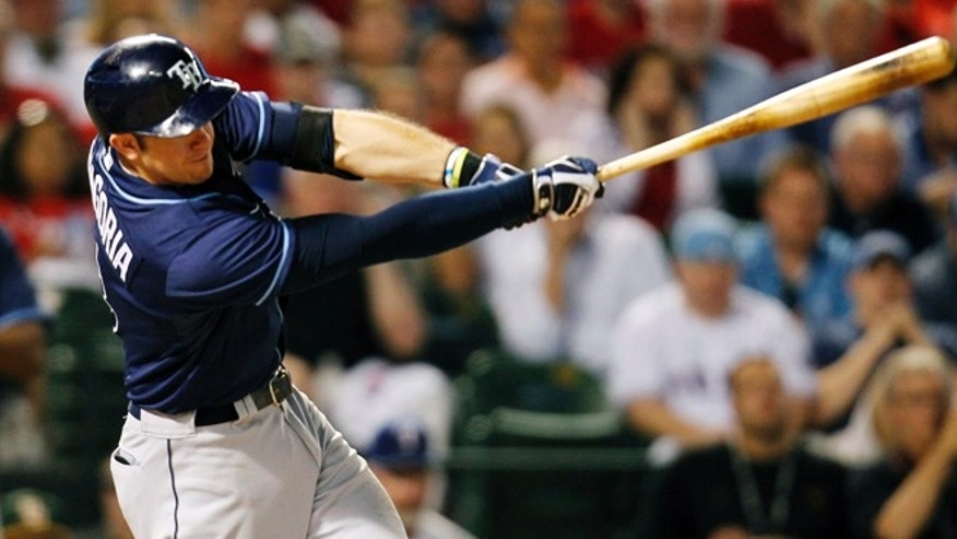 Tampa Bay Rays' Evan Longoria doubles during the sixth inning of an American League wild-card tiebreaker baseball game against the Texas Rangers Monday, Sept. 30, 2013, in Arlington, Texas. (AP Photo/Tim Sharp)