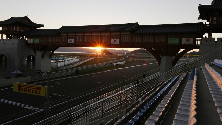 FILE - In this Oct. 11, 2012 file photo, the sun sets over the Korean International Circuit ahead of the Korean Formula One Grand Prix in Yeongam, South Korea. Formula One championship leader Sebastian Vettel is cautious about the prospects of Red Bull continuing its dominance at this weekend's Korean Grand Prix, saying the layout of the circuit does not suit the car's strengths. The Yeongam circuit in South Korea combines both elements, with long straights and a technical and tight finish. The Korean Grand Prix is scheduled on Oct. 4, 2013.  (AP Photo/Mark Baker)
