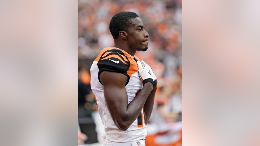 Cincinnati Bengals wide receiver A.J. Green watches from the sidelines late in the fourth quarter of a 17-6 loss to the Cleveland Browns in an NFL football game Sunday, Sept. 29, 2013, in Cleveland. (AP Photo/Tony Dejak)