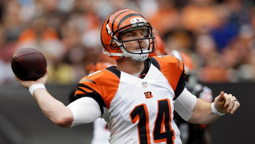 Cincinnati Bengals quarterback Andy Dalton passes in the third quarter of an NFL football game against the Cleveland Browns, Sunday, Sept. 29, 2013, in Cleveland. (AP Photo/Tony Dejak)