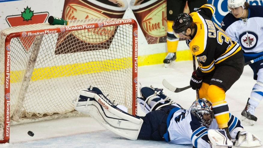Boston Bruins defenseman Zdeno Chara puts the puck past Winnipeg Jets goalie Al Montoya for a goal during the second period of an NHL hockey preseason game Friday, Sept. 27, 2013, in Saskatoon, Saskatchewan. (AP Photo/The Canadian Press, Liam Richards)