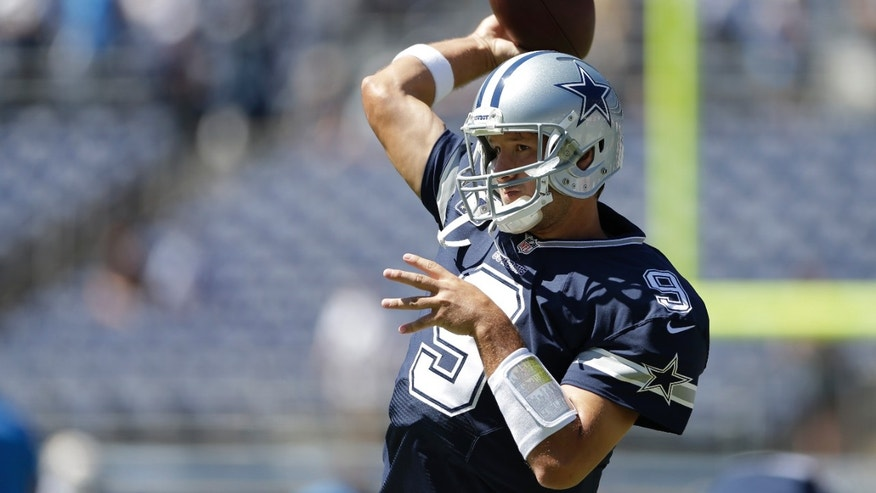 Dallas Cowboys quarterback Tony Romo warms up before an NFL football game against the San Diego Chargers Sunday, Sept. 29, 2013, in San Diego. (AP Photo/Gregory Bull)
