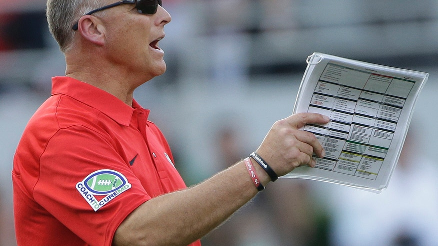 Georgia head coach Mark Richt speaks to players during the first half of an NCAA football game against LSU, Saturday, Sept. 28, 2013, in Athens, Ga. (AP Photo/John Bazemore)
