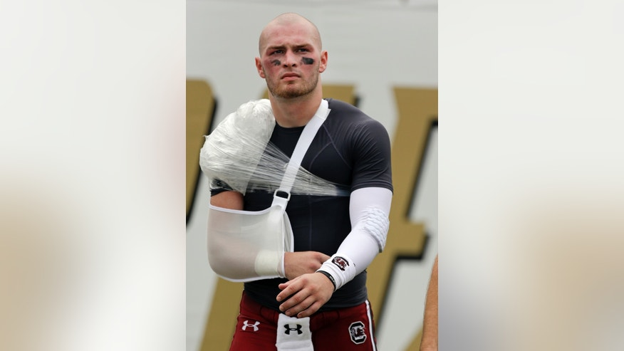 South Carolina quarterback Connor Shaw walks the sidelines after he was injured on a play against Central Florida during the first half of an NCAA college football game in Orlando, Fla., Saturday, Sept. 28, 2013.(AP Photo/John Raoux)
