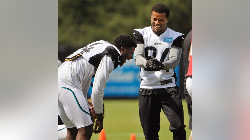 Jacksonville Jaguars wide receiver Justin Blackmon, left, and Cecil Shorts share a laugh during during NFL football practice, Wednesday, Oct. 2, 2013, in Jacksonville, Fla. Blackmon returned to the team Wednesday, after a four-game suspension for violating the league's substance-abuse policy. (AP Photo/The Florida Times-Union, Will Dickey)