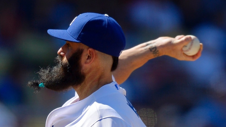FILE - This Aug. 24, 2013 file photo shows Los Angeles Dodgers relief pitcher Brian Wilson pitching during the eighth inning of the Dodgers' baseball game against the Boston Red Sox, in Los Angeles. Many a bearded major leaguer disapproves of the bushy black mess hanging low from Brian Wilson's chin these days.  Yet there's no arguing the beard's potential as the relief pitcher chases a third World Series ring in four years. (AP Photo/Mark J. Terrill)