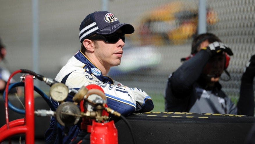 Brad Keselowski watches practice for Sunday's NASCAR Sprint Cup series auto race, Saturday, Sept. 28, 2013, at Dover International Speedway in Dover, Del. (AP Photo/Nick Wass)
