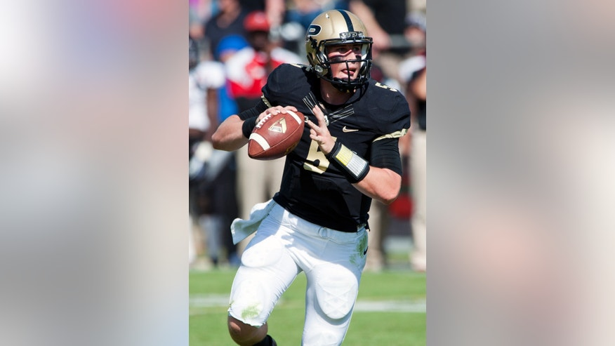 Purdue quarterback Danny Etling looks to pass the ball against Northern Illinois during an NCAA college football game in West Lafayette, Ind. on Saturday, Sept. 28, 2013. (AP Photo/The Journal & Courier, Brent Drinkut)