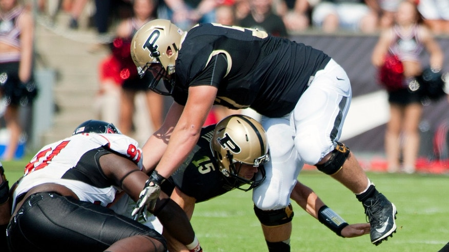 Purdue quarterback Rob Henry loses the football against Northern Illinois during an NCAA college football game at Ross-Ade Stadium, in West Lafayette, Ind., on Saturday, Sept. 28, 2013. (AP Photo/The Journal & Courier, Brent Drinkut ) MANDATORY CREDIT; NO SALES
