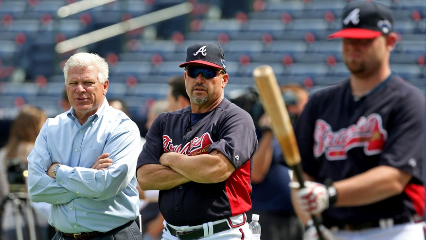 Atlanta Braves general manager Frank Wren, left, talks with manager Fredi Gonzalez as they watch batting practice Wednesday, Oct. 2, 2013, in Atlanta. The Braves are scheduled to play the Los Angeles Dodgers in Game 1 of baseball's NL division series on Thursday. (AP Photo/Atlanta Journal Constitution, Jason Getz) MARIETTA OUT  GWINNETT OUT  LOCAL TV OUT (WXIA, WGCL, FOX 5)