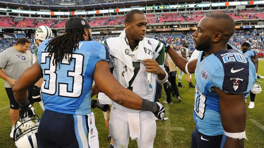 New York Jets quarterback Geno Smith (7) talks with Tennessee Titans players Michael Griffin (33) and Alterraun Verner (20) after the Jets lost to the Titans 38-13 in an NFL football game on Sunday, Sept. 29, 2013, in Nashville, Tenn. (AP Photo/Mark Zaleski)