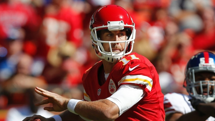 Kansas City Chiefs quarterback Alex Smith (11) looks for a receiver during the first half of an NFL football game against the New York Giants at Arrowhead Stadium in Kansas City, Mo., Sunday, Sept. 29, 2013. (AP Photo/Ed Zurga)