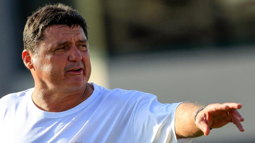 Southern California interim football coach Ed Orgeron guides his players at the Los Angeles USC campus on Wednesday, Oct. 2, 2013. (AP Photo/Damian Dovarganes)
